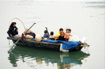 An old woman and her family in a rowing boat in Along Bay. © Philip Plisson / Pêcheur d'Images / AA12463 - Photo Galleries - Along Bay, Vietnam